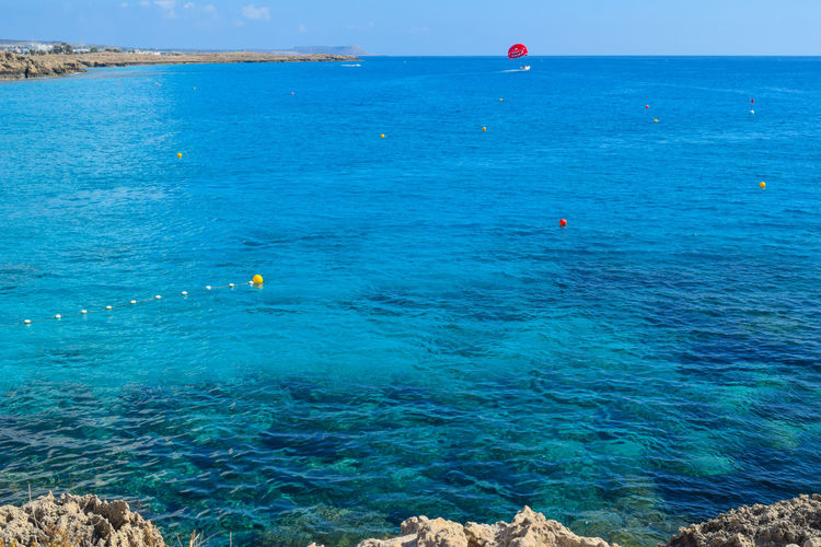 Nissi beach parasailing in Cyprus Adventure Club Extreme Family Fun Vacations Activity 1 Adventure Beach Beauty In Nature Blue Day Extreme Sports Flying Horizon Over Water Leisure Activity Nature Outdoors Parachute Paragliding Real People Scenics Sea Sky Tranquil Scene Water