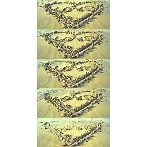 """People do write """"I love you"""" on a beautiful beach.❤️"""