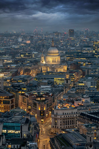 Aerial view over the skyline of London to St. Pauls Cathedral in the evening time City Architecture Building Exterior Built Structure Cityscape High Angle View Building Travel Destinations Sky Illuminated Dusk Dome Travel Outdoors City Life London St Paul's Cathedral United Kingdom Evening Aerial View Urban Skyline Lights City Street Grey