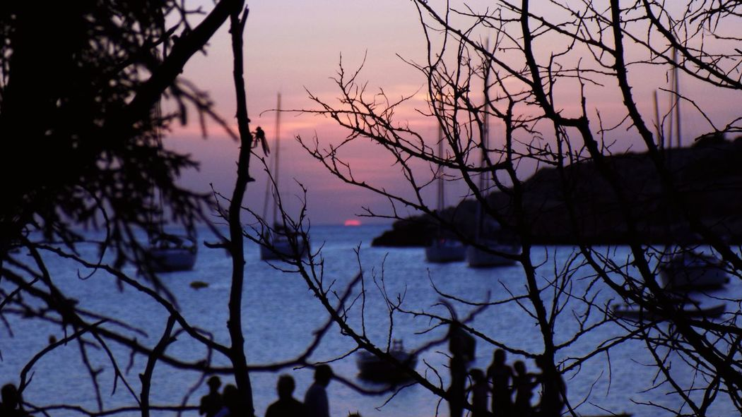 Sunset Sunset Silhouettes Boats⛵️ Boats And Sea Adults Only Silouette & Sky Summer Time ☀ Scenics People Transportation Nautical Vessel Landscape Beauty In Nature Outdoors Sky Silhouette Water Nature Reflection Dusk Tree Branch Ibiza, Spain Cala Salada Your Ticket To Europe