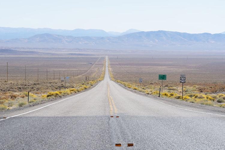 Empty road along landscape