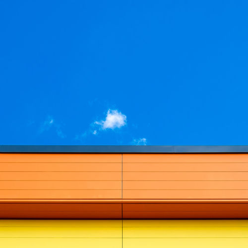 Cloudminimal Minimalism Minimalobsession Minimalist Photography  Ralfpollack_fotografie Cloud Sky Blue Copy Space No People Outdoors Day Yellow Architecture Cloud - Sky Wall - Building Feature Vibrant Color Pattern Orange Color Multi Colored
