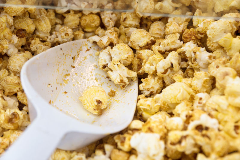 sweet popcorn and shovel in a popcorn machine shop, selected focus, narrow depth of field Golden Hot Machine Popcorn Snack Sugar Calories Cinema Corn Food Food And Drink Fresh Freshness Honey No People Ready-to-eat Shovel Sweet