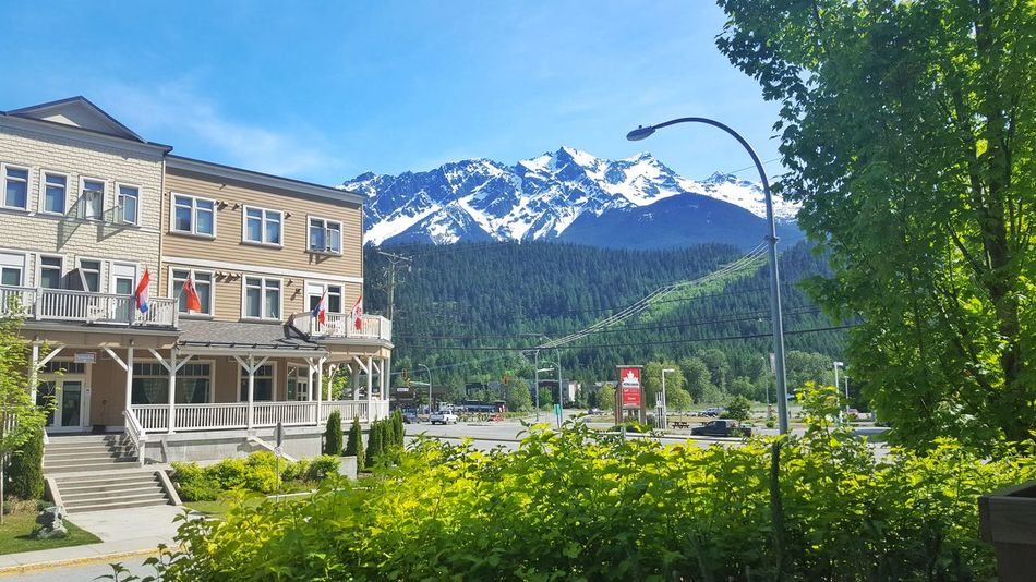 Mountain Blue Sky Clear Sky Outdoors No People British Columbia, Canada Pemberton Clear Sky Historic Building Architecture Canada Heritage Building Snowcapped Mountain Mountain Peaks Tranquil Relaxing Sunshine Summer Adapted To The City Flags Leaves Green Live For The Story