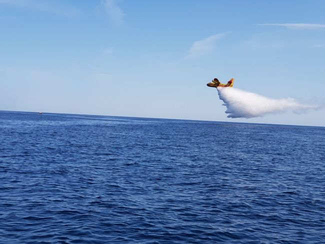 fire plane corsica Fire Fire Plane Water Sea Aerobatics Flying Stunt Blue Full Length Mid-air Sky Horizon Over Water Firefighter Rescue