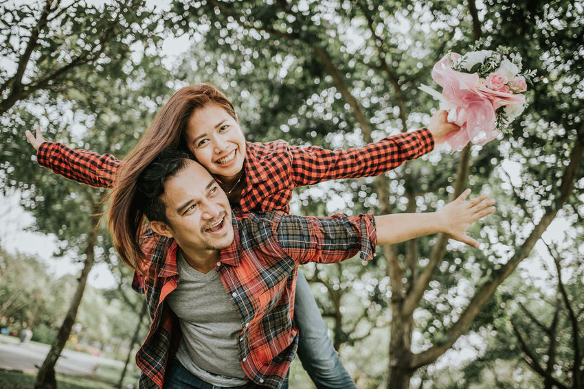 Couple Fun Happy Love Lover Man Married Piggyback Relationship Romantic Valentine Woman Boyfriend Cheerful Enjoying Life Female Girlfriend Lifestyles Male Outside Smile Togetherness