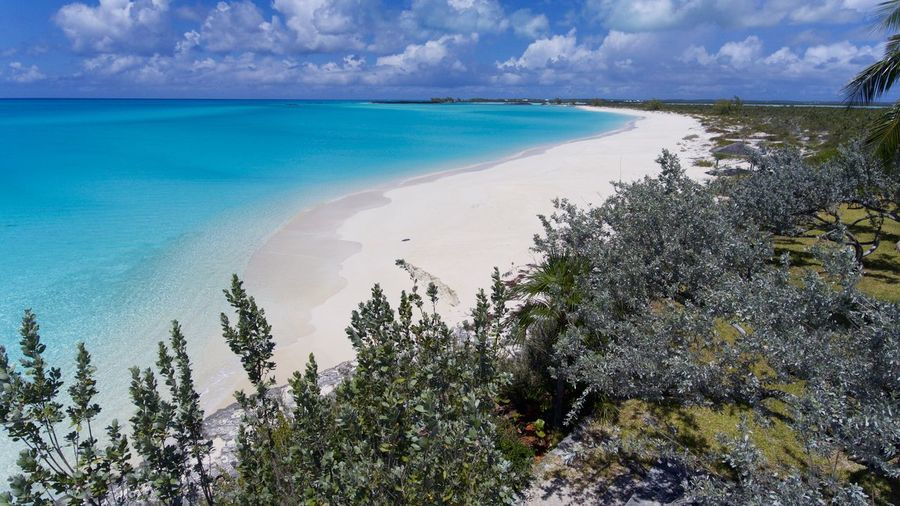 Pristine Beach! Aerial Photography Bahamas Beaches Of The World Turquoise Colored Sea Water Beach Beauty In Nature Land Sky Tranquility Scenics - Nature Tranquil Scene Cloud - Sky Nature Day Idyllic No People Sunlight Outdoors Horizon Over Water