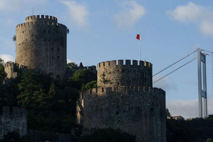 towers of the historic 15th century fortress of Rumeli Hisar on the Bosphorus 15th Century Architecture Bridge Building Castle Day Fatih Sultan Mehmet Koprusu Flag Fort Fortress History Istanbul No People Old Ottoman Outdoors Rumeli Hisari Castle Rumeli Hisarı Tower Turkey Turkish Walls