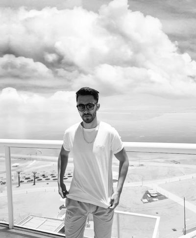 Looking At Camera Sea Day Portrait Front View Three Quarter Length Casual Clothing Sunglasses Fashion Nature Standing Outdoors Leisure Activity