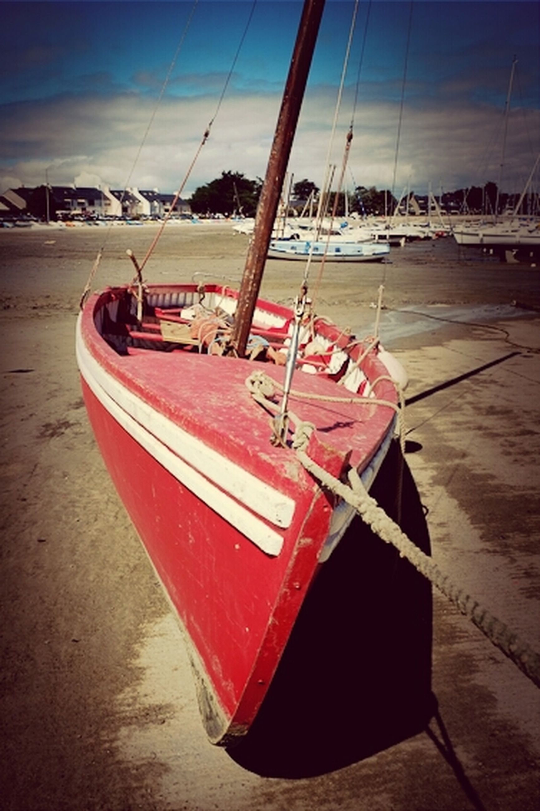 transportation, mode of transport, nautical vessel, sky, moored, red, boat, water, sea, outdoors, no people, day, travel, harbor, absence, rope, cloud - sky, sunlight, metal, empty