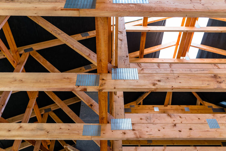 Roof trusses covered with a membrane on a detached house under construction, visible roof elements