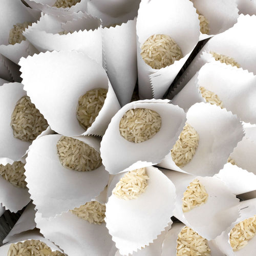 Full frame shot of raw rice in conical shape papers