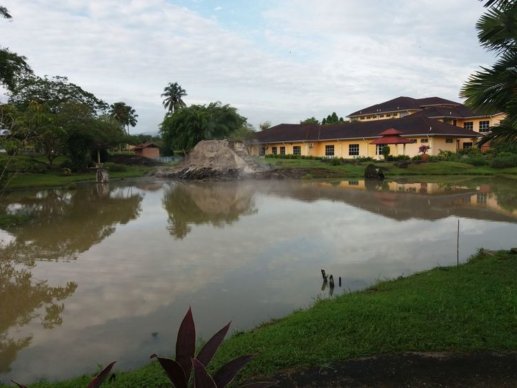 The Hulu langat town 9 hot spring Water House Reflection Outdoors Lake Architecture Residential Building Building Exterior Extreme Weather Built Structure Tree Nature Sky Mountain Day No People Flood Politics And Government