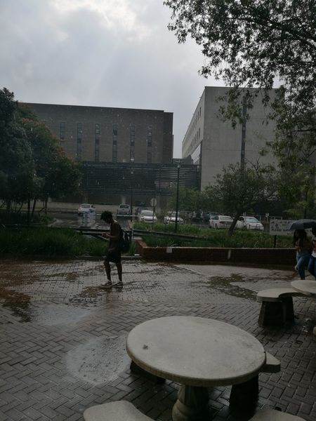 Water Wet Watering Fountain Outdoors People Architecture One Person Day Adults Only Adult Rain Storm Nature Johannesburg Wits University Table Outdoor En Route Street Style Street Resist