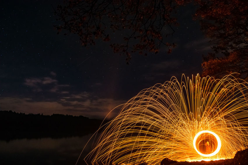 Sleepless EyeEm Best Shots Blurred Motion Illuminated Long Exposure Motion Nature Night No People Orange Color Sky Steelwool Water Waterfront