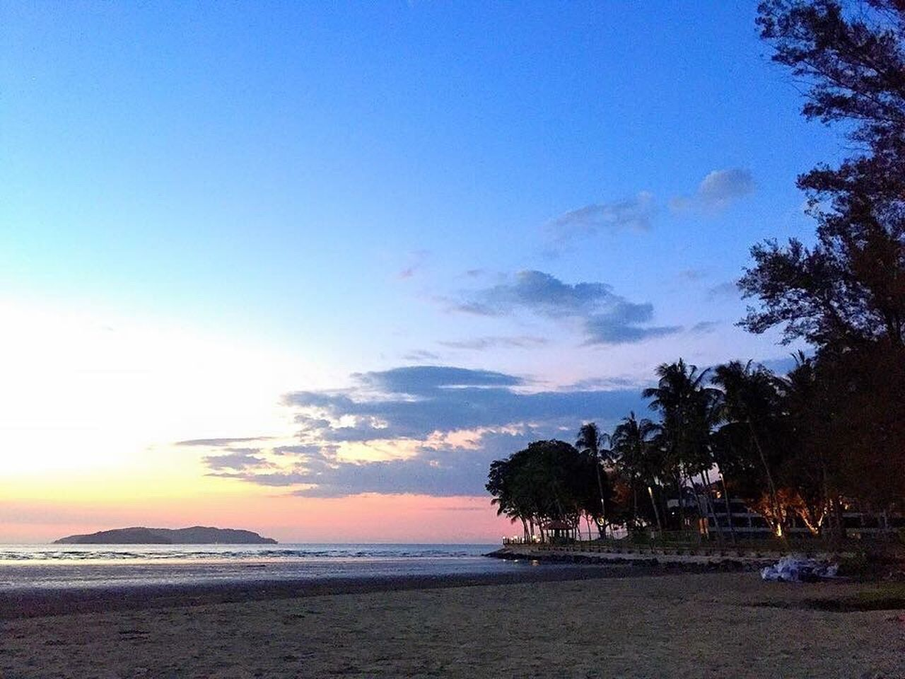 beach, sea, tree, sky, water, sunset, beauty in nature, tranquility, nature, scenics, tranquil scene, horizon over water, no people, outdoors, blue, palm tree, day