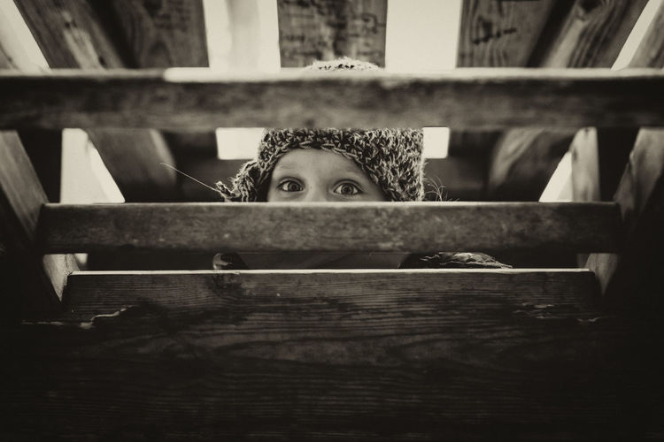 Hide Black & White Children EyeEm Best Shots Family Happiness Kids Child Childhood Eyes First Eyeem Photo Front View Full Frame Girl Headshot Hide Hiding Kid Leisure Activity Looking Looking At Camera Monochrome Peeking Playing Portrait Wood - Material The Portraitist - 2018 EyeEm Awards EyeEmNewHere