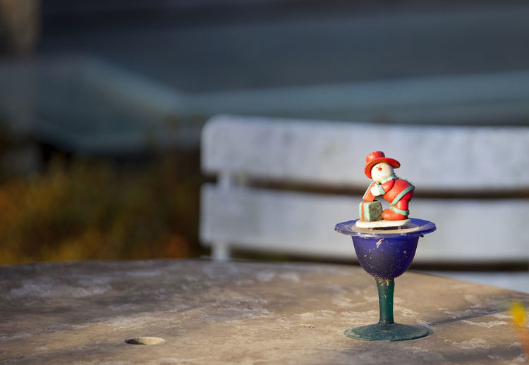 No People Representation Focus On Foreground Toy Day Art And Craft Close-up Table Human Representation Creativity Nature Still Life Outdoors Craft Selective Focus Red Water Figurine