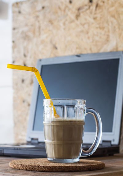 Close-up Coffee Coffee - Drink Coffee Cup Cup Drink Drinking Glass Drinking Straw Food Food And Drink Freshness Glass Household Equipment Indoors  Latte Mug No People Refreshment Still Life Straw Table