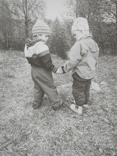 Two children standing on field
