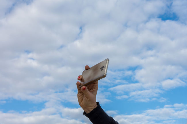 Blue Cellphone Cloud - Sky Clouds And Sky Hand Holding Human Body Part Human Hand Low Angle View Mobile Phone One Person Outdoors Selfie Sky Adults Only EyeEm Team EyeEm Gallery EyeEm Leisure Activity Mobile Love Mobile Conversations