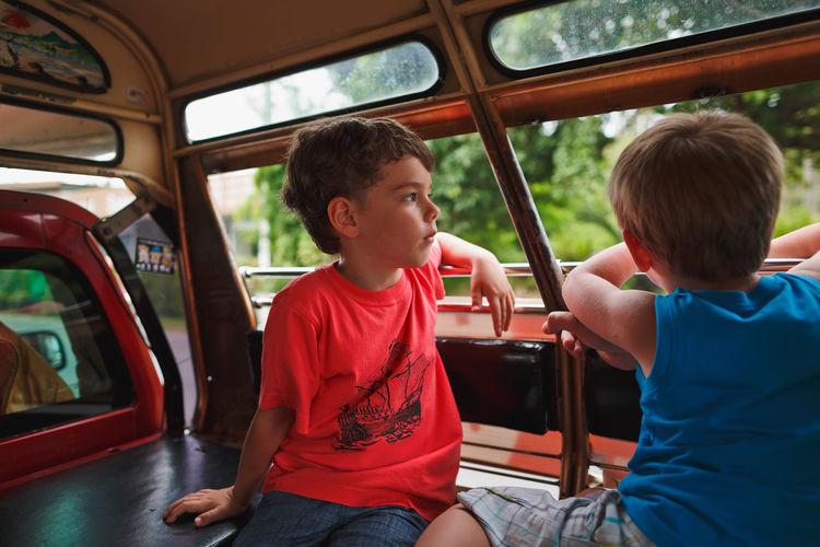 Boy sitting in bus