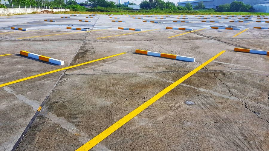 High angle view of zebra crossing in parking lot