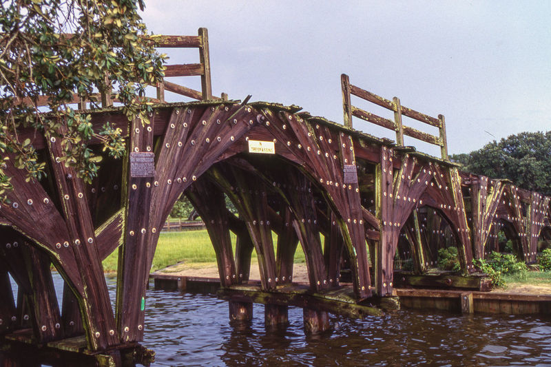 1997 - Near the Whalehead Beach Club 19th Century Bridge Currituck Sound Salt Marsh Architecture Bridge Bridge - Man Made Structure Built Structure Connection Day Nature No People Outdoors Plant Sky Tranquility Tree Water Waterfront Wood - Material Wooden Bridge Over Water