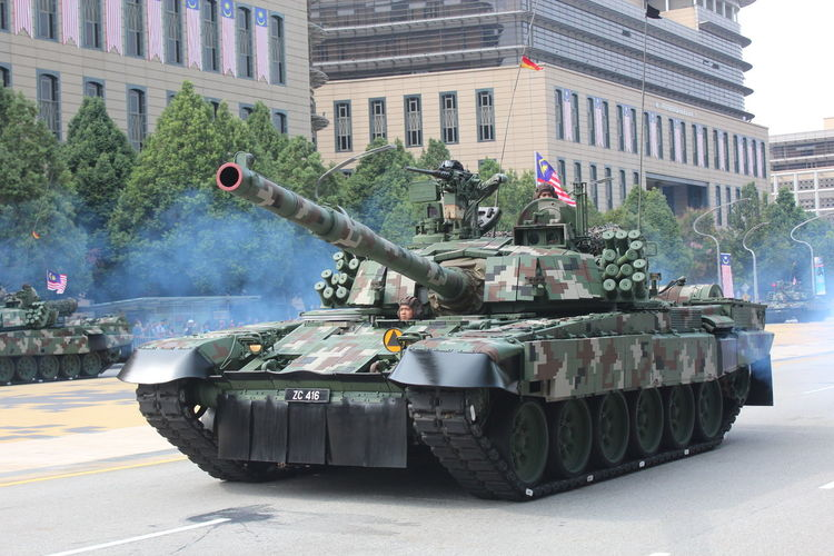 Aggression  Architecture Armed Forces Armored Tank Building Exterior Built Structure Cannon City Conflict Day Fighting Government Military Mode Of Transportation Motion Outdoors Road Security Tank Transportation War Weapon