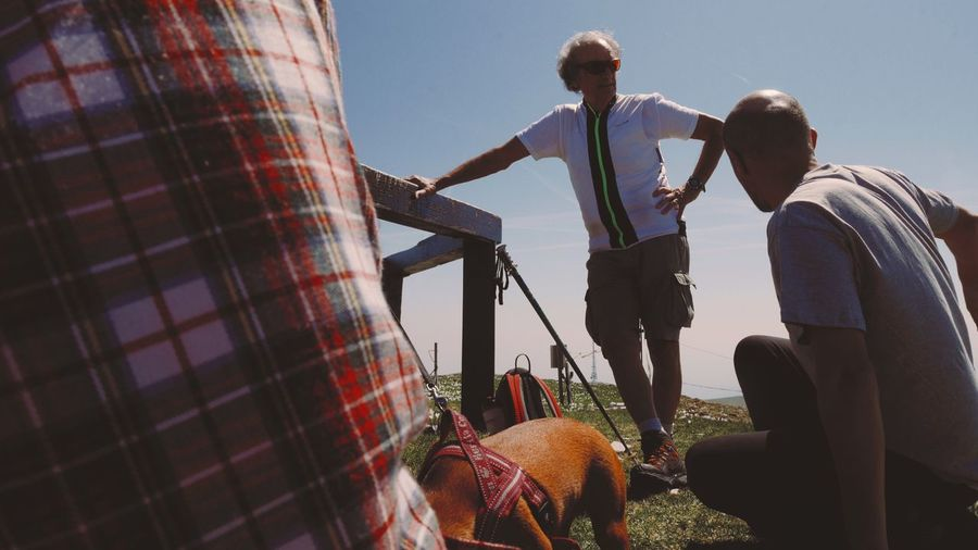 Men On Field Against Sky