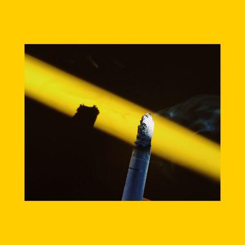 Close-up of yellow smoking