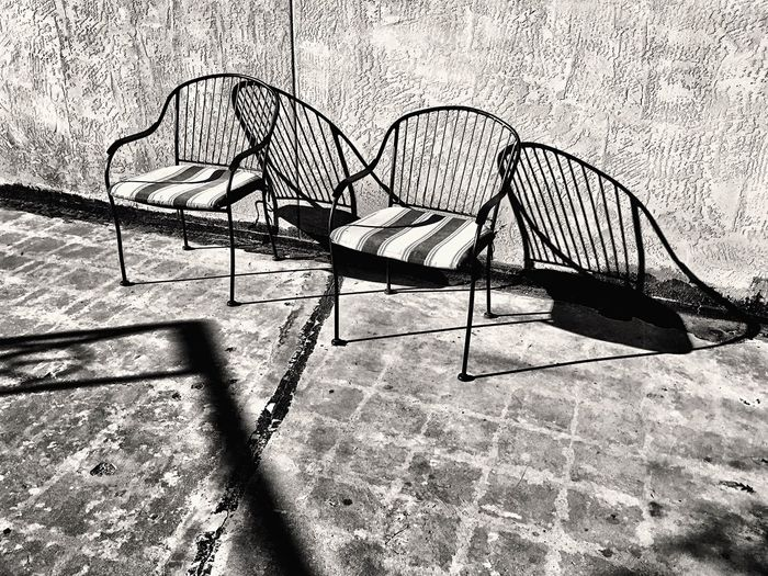 Chair Sunlight No People Day Outdoors Sunlight And Shadow Petroleum Building Building Exterior Empty Chairs Monochrome Photography IPhoneography