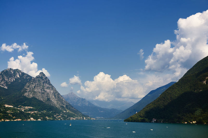 Alpine lake Lugano in Switzerland and Italy.. Alpine Lake Alps Beauty In Nature Border Ceresio Cloud Color Day Idyllic Lago Di Lugano  Lake Landscape Majestic Mountain Mountain Range Nature No People Non Urban Scene Non-urban Scene Outdoors Power In Nature Scenics Sky Blue Tranquility Travel Destinations
