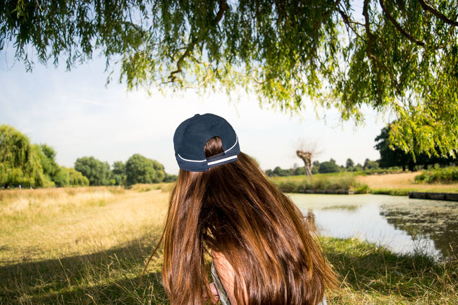 Beauty In Nature Brown Hair Capture The Moment Cousins  Day Experimenting EyeEm Gallery EyeEm Nature Lover Eyeem Photography Family Grass Hair And Beauty Natural Beauty Nature One Person One Young Woman Only Outdoors People Portrait Photography Rear View Sunlight Tree Womens Portraiture