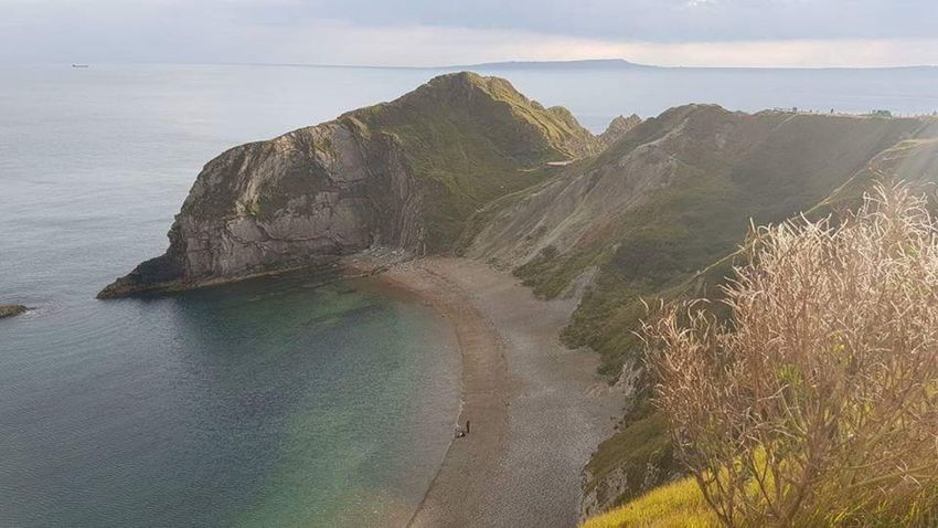 Looking down on the Beach Travel Photography Travel Destinations Beachphotography Beach Photography Durdle Door Ocean Looking Down Looking Down From Above An Eye For Travel Landscape Mountain Nature Outdoors No People Beauty In Nature Day Scenics Water Sky