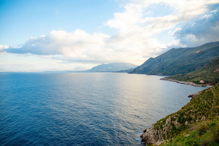 Sicily Italy Cloud - Sky Scenics - Nature Mountain Beauty In Nature Water Sky Tranquil Scene Sea Tranquility Mountain Range Non-urban Scene Idyllic Nature Day Waterfront No People Outdoors Remote Blue