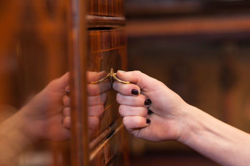 Close-Up Of Woman Opening Drawer