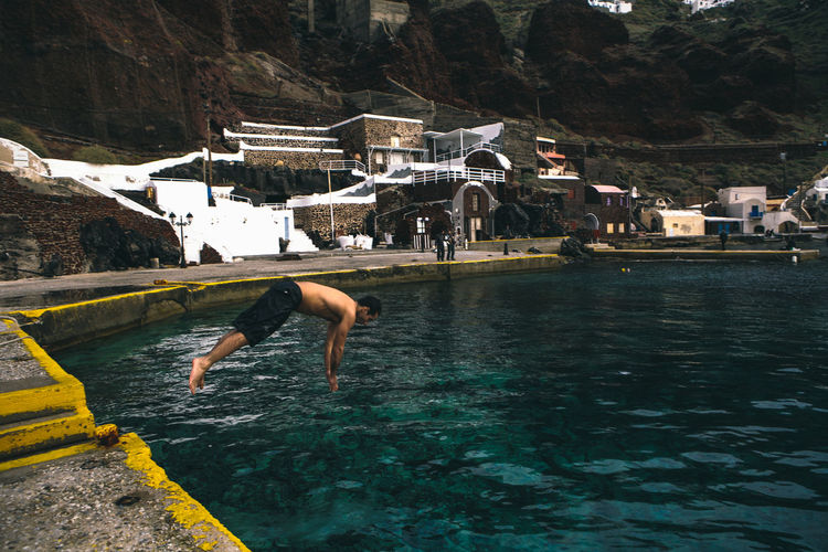 Diving in. Aegean Sea Diving Enjoyment Fun Greece Jump In The Sea Jump In The Water  Jumping Leisure Activity Live For The Story Mid-air Oia One Person Outdoors Pier Real People Santorini Shirtless Summer Swim Swimming Taking The Plunge Vitality Water Waterfront Be. Ready. The Traveler - 2018 EyeEm Awards