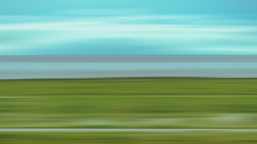 Full frame shot of green land against sky
