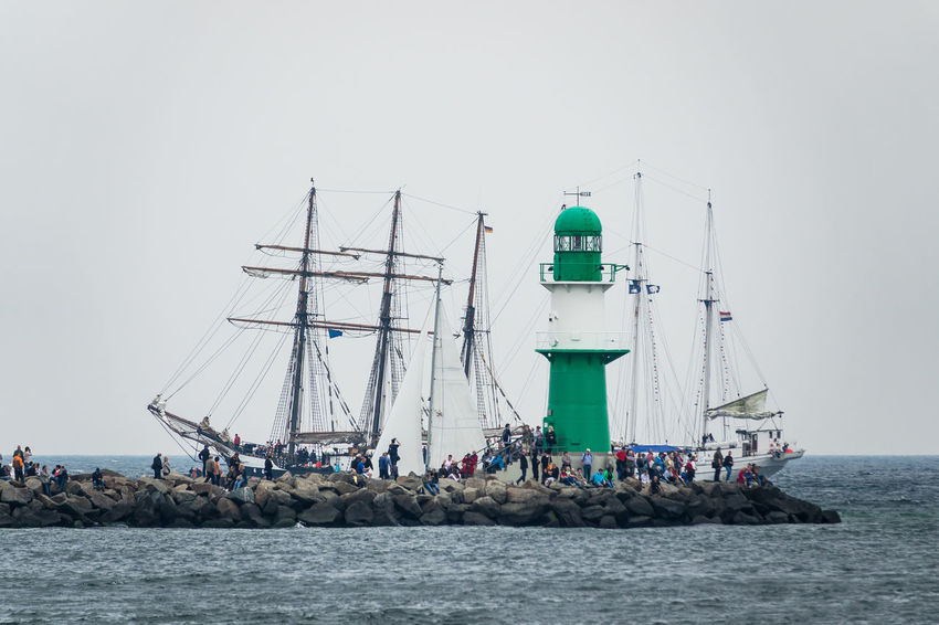 Sailing ships in Warnemuende, Germany. Baltic Sea Hanse Sail HanseSail Lighthouse Rostock Tall Ship Warnemünde Day Mast Mole Nature Nautical Vessel No People Outdoors Sailboat Sailing Sailing Ship Sea Ship Sky Tourism Transportation Travel Destinations Water Windjammer