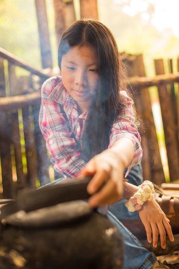 Adult Boil Child China Chinese Coffee Cold Cooking Day Food Girl Human Body Part Human Hand Junior High Lifestyles One Person Outdoors People Portrait Portrait Of A Woman Smiling Smoke Thai Woman Young Adult Women Around The World