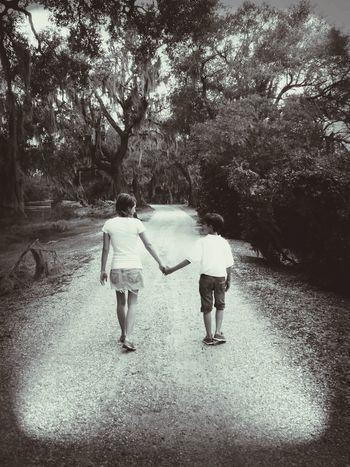 Walking Full Length Rear View Togetherness Outdoors The Way Forward Eye Of Ky Louisiana Sibling Love Siblings ♡ Brother & Sister Mossy Oaks Oak Trees Lovely Louisiana Nature People And Places