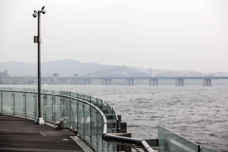 Distant View Of Dongjak Bridge Over Han River Seen From Promenade
