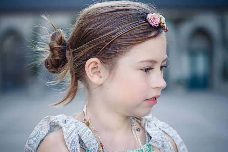 Close-Up Of Girl Wearing Headband