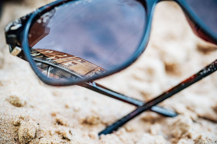 Close-up of sunglasses on land