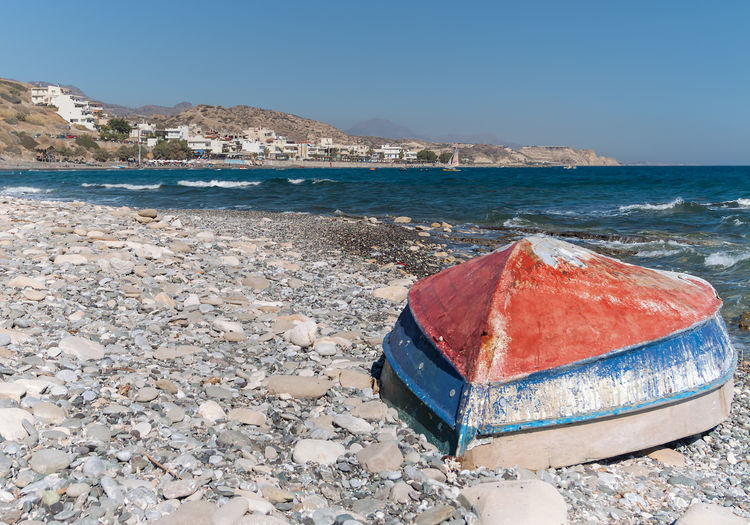 The Red Surf Beach Blue Boat Clear Sky Cobblestone Fishing Boat Mirtos Mirtos, Crete Ocean Outdoors Pebbles Rocks Rocks And Water Sand Scenics Sea Shore Shoreline Sky Water
