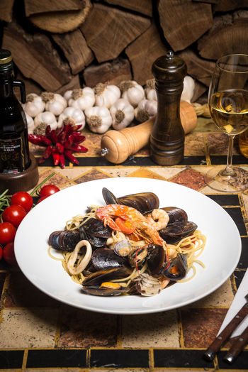 Dinner Time Food And Drink Chef Day Delicious Drinking Glass Food Food And Drink Fork Freshness Healthy Eating Indoors  Italian Food Kitchen Launch Mussel No People Place Setting Plate Plateu Ready-to-eat Seafood Spaghetti Spices Table Tasteful Wineglass