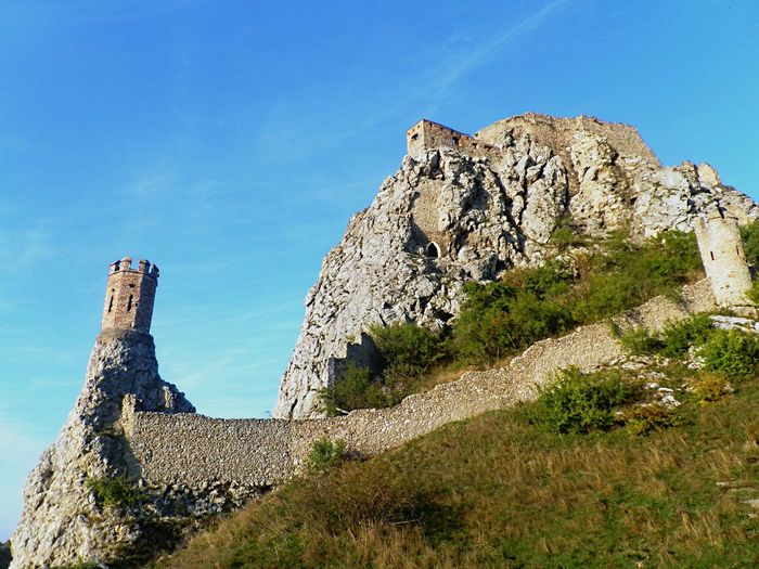 Castle Ruins Sightseeing Ancient Civilization Beauty In Nature Blue Devin Castle Formation Fortification Fortress Historical History Land Low Angle View Medieval Nature No People Outdoors Rock Rock - Object Rock Formation Scenics - Nature Sky The Past Tranquility The Great Outdoors - 2018 EyeEm Awards EyeEmNewHere