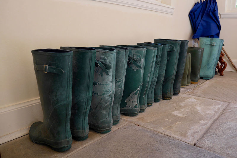 Boots Diagonal Lined Up Overshoes Rain Boots Rain Rubbers Rubber Boots Rubbers Tile Floor Umbrellas Wellies  Wellington Boots Let's Go. Together.