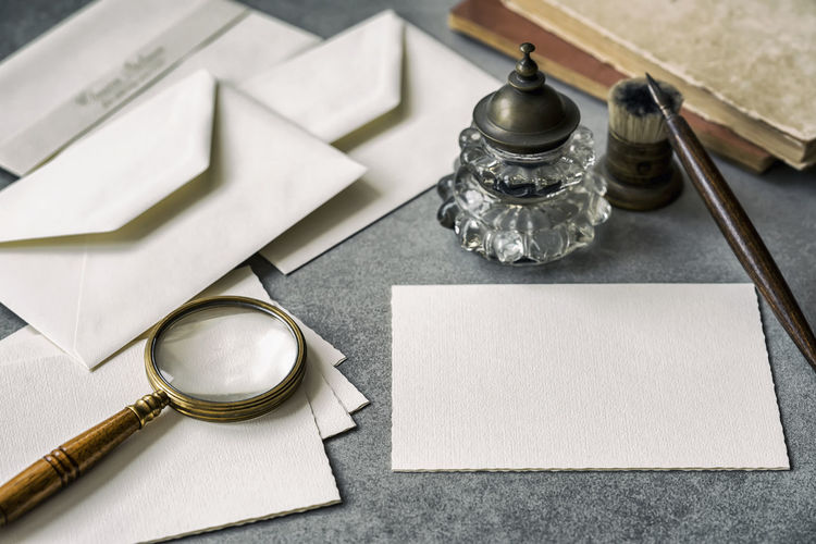Set of vintage writing stationery items, wooden pen, inkwell, magnifier and envelopes, letters closeup. Nostalgic background, place for text Still Life Paper Antique Close-up Table Blank No People High Angle View Ink Well Household Equipment Pen Fountain Pen Setting Pepper Shaker Inkwell Memory Nostalgia Vintage Letters Feather  Empty Flat Flat Lay